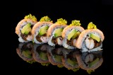 Baked rainbow roll with boiled shrimp and vegetables topped with salmon, green dressing, sweet sauce and sesame seeds (5 pcs)