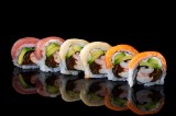 Rainbow roll with boiled shrimp and vegetables topped with salmon, tuna and butterfish (6 pcs)