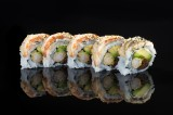 Dragon Roll with tempura shrimp and vegetables topped with baked eel, sweet sauce and sesame seeds (5 pcs)
