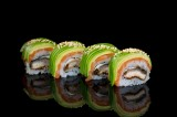 Caterpillar Roll with baked eel and marinated pumpkin topped with salmon, avocado, sweet sauce and sesame seeds (4 psc)
