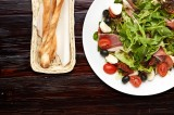 7. Variety of lettuce with Parma ham, white mozzarella cheese, dried tomatoes, black olives, cherry tomatoes and rocket