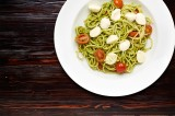 17. SPAGHETTI CON PESTO E MOZZARELLA – spaghetti pasta with basil pesto, cherry tomatoes and balls of white mozzarella