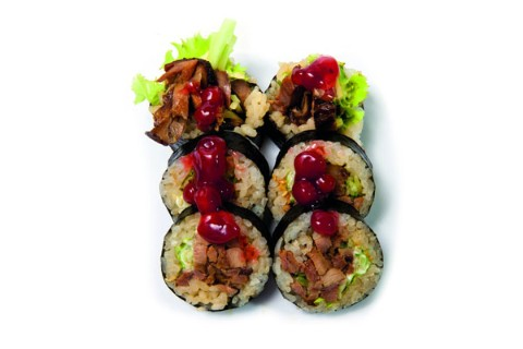 Fried duck with teriyaki sauce and cranberry